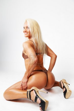 Squatting long-haired sportswoman