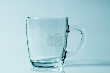 A transparent cup in a studio