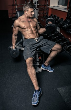 Muscled man lifting weights