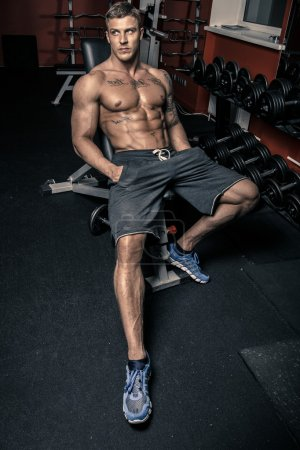 Fit handsome guy in blue sneakers