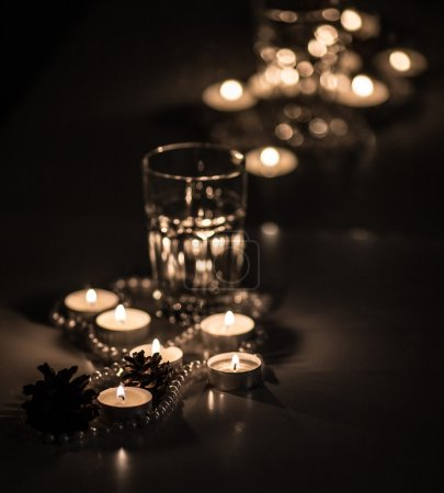 Pearl beads and candles in a romantic setting