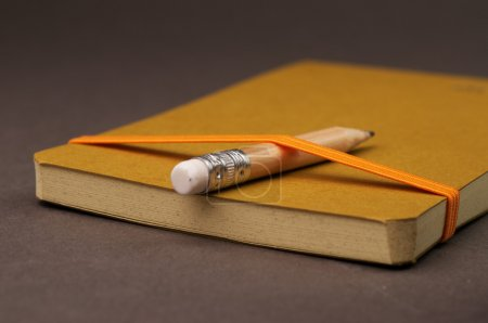 Pencil with notebook