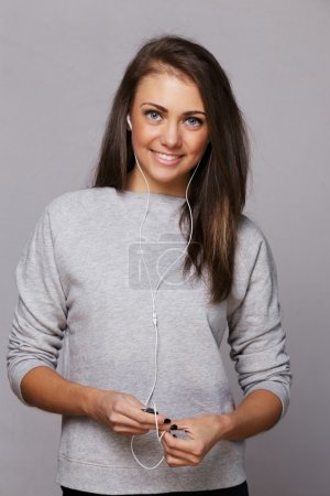 Girl in a gray shirt with earphones