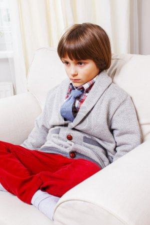Boy on white sofa