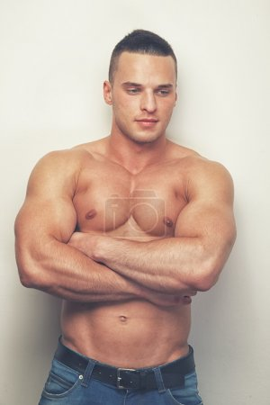 Shirtless man with crossed arms
