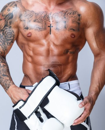 Photo for Tattooed boxer man torso wearing white gloves - Royalty Free Image