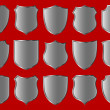 Silver shield design set with various shapes...
