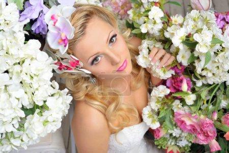 beautiful chic woman around the flowers.