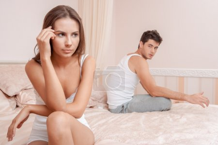 Photo for Woman and man having a disagreement, Young couple in a bed bored woman - Royalty Free Image