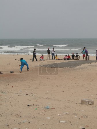 Young Indian boys play cricket