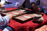 Two men playing a game of backgammon