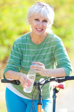 Mature woman with bicycle