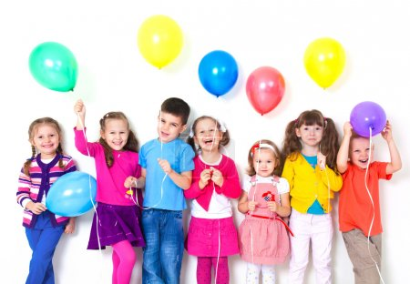 Photo for Big group of happy children with balloons at white wall - Royalty Free Image