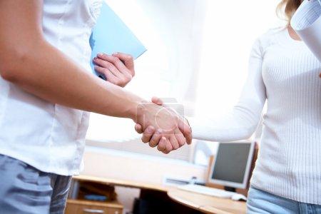 Handshake womens colleagues