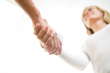 The friendly businesswoman keeps women's hands in ...