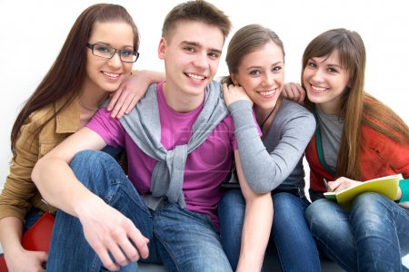 Close-up of four teenagers laughing and looking at...