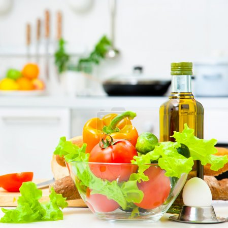 Healthy foods are on the table in the kitchen...