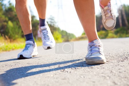 Photo for Close-up of pair of feet runners - Royalty Free Image