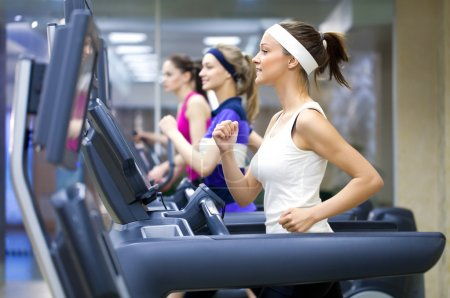 Photo for Group of young running on treadmill in gym - Royalty Free Image