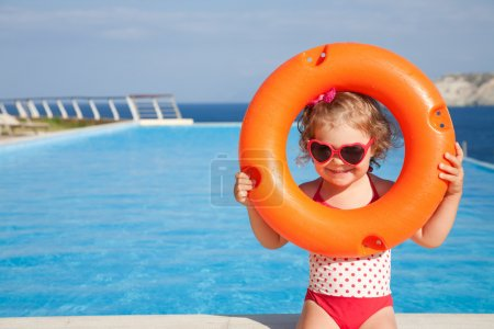 little girl goes to pool