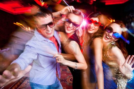 Photo for Group of young having fun dancing at party. - Royalty Free Image