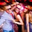 Group of young having fun dancing at party....