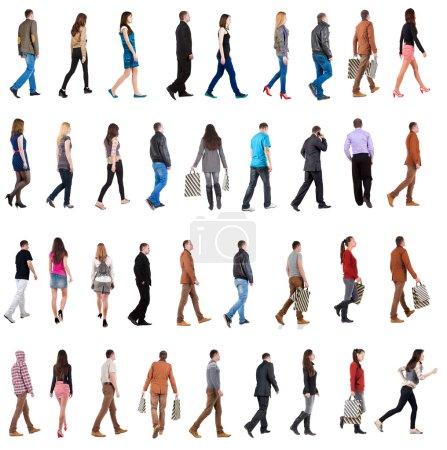 Photo pour Collection « vue arrière de la marche ». aller les hommes et une femme dans le jeu de mouvement. vue arrière de la personne. collection de vue arrière. isolé sur fond blanc. - image libre de droit