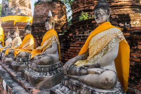 Typical buddha statue at the hystoric parks in Tha...