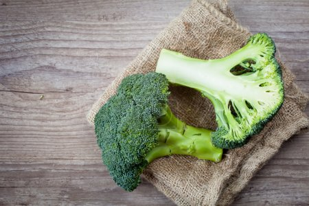 Bunch of fresh green broccoli on wooden background