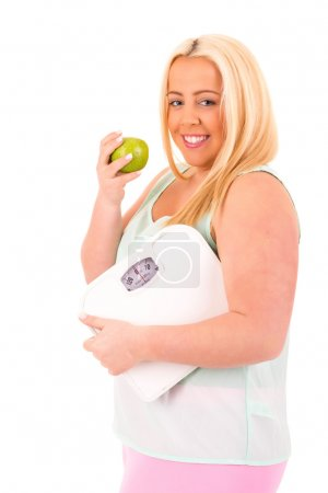 Photo for Large woman holding a scale - diet concept - Royalty Free Image