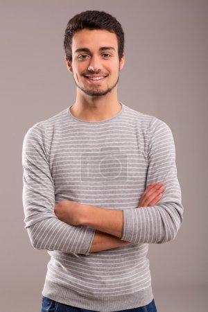 Photo for Studio picture of a young and handsome man posing isolated - Royalty Free Image