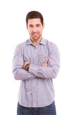 Foto de Imagen del estudio de un hombre joven y guapo posando aislado - Imagen libre de derechos