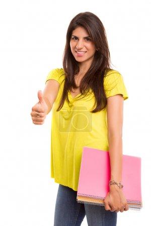 Photo pour Une belle étudiante posant isolée sur un fond blanc - image libre de droit