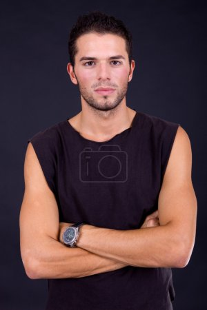 Young casual man portrait on a black background