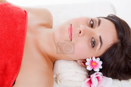 Beautiful young woman getting spa treatment