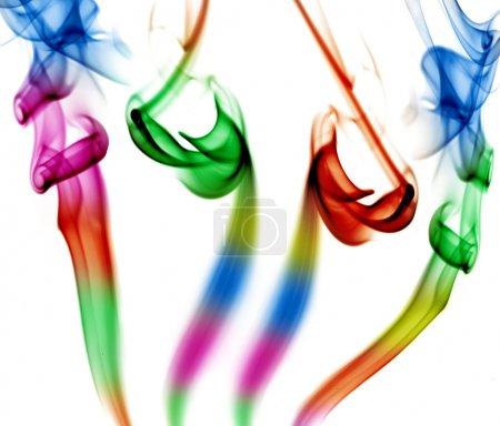 Photo pour Fumée colorée abstraite en fond blanc - image libre de droit
