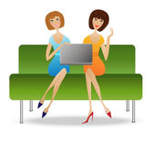 two young woman with notebook sit on sofa