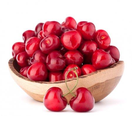 Cherry berries in wooden bowl