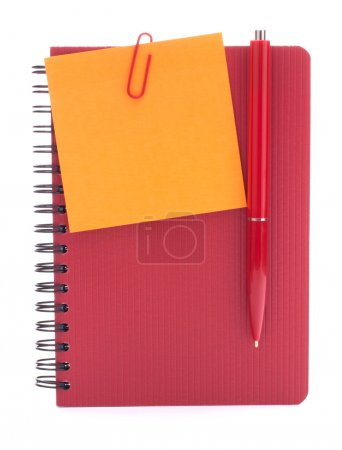 Red notebook with notice paper and pen