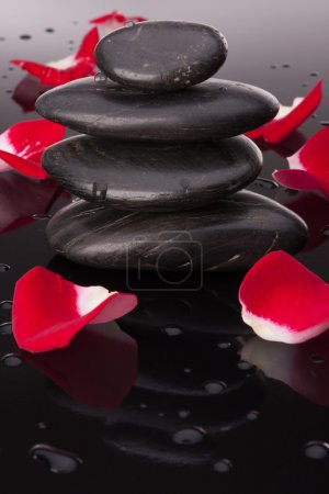 Spa stones and flower petals