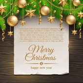 Paper banner with Christmas greeting and coniferous branches with golden decor