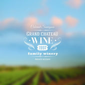 Wine label type design against a vineyards landscape defocused background