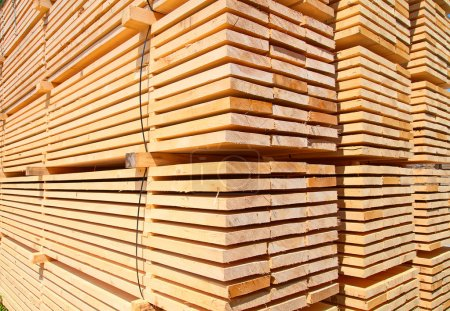 Stack of new wooden studs at the lumber yard...