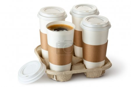 Four take-out coffee in holder. One cup is opened.