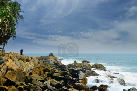 Man on a rocky shore