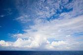 Beautiful cloudscape over a blue ocean