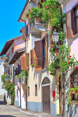 Italian house decorated with flowers in Piedmont, Italy.