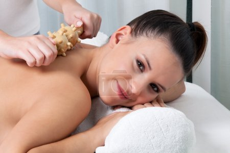 Photo for Woman receiving a back massage in spa. - Royalty Free Image