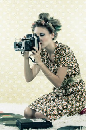 Photo for Woman taking photograph from vintage 4x6 film camera . - Royalty Free Image