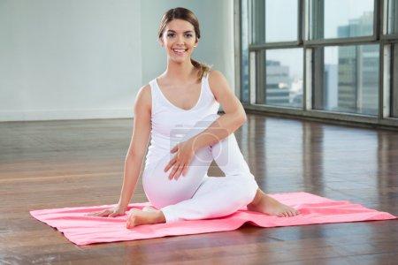 Happy Woman Practicing On Yoga Mat